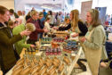 Lively trade as customers meet sellers at the food festival