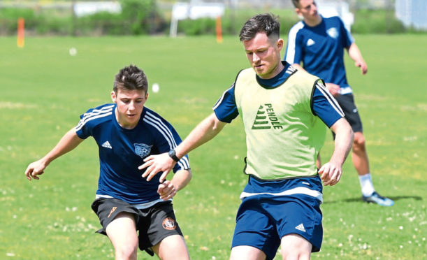 Paddy Boyle, right, in training for Peterhead.