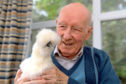Tor-Na-Dee care home resident Sandy Burnett with Piper, one of two chickens who have moved in