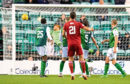 Aberdeen's Dominic Ball see's his free-kick rattle the crossbar against Hibs.