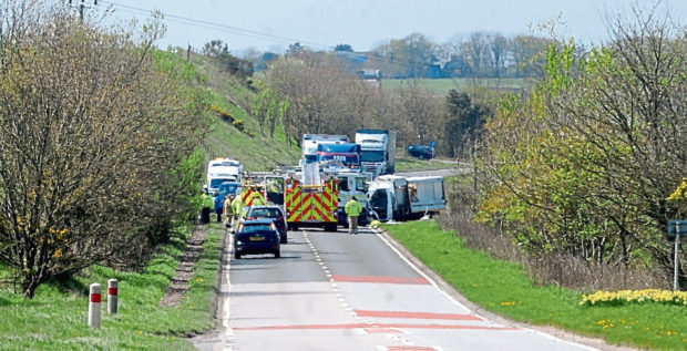 Emergency services attend the scene of the crash which killed William Buchan on the A90 in May 2016