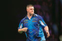 Daryl Gurney reacts during his match against Michael van Gerwen in the 2018 Unibet Premier League at The Manchester Arena on April 26, 2018 in Manchester, England.