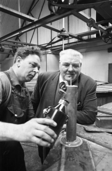 1970: Adam Innes, the distillery brewer of historic Glen Grant Distillery in Rothes, looks at the hydrometer