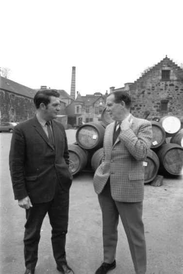 1970: Major Douglas MacKessack, right, managing director of Glen Grant Distillery, chats with the manager Mr E Sherret