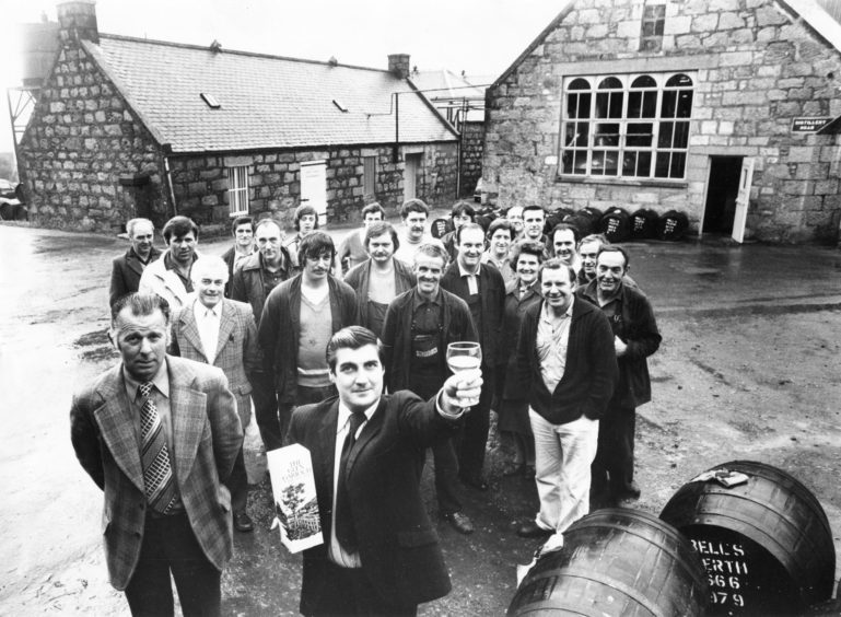 1979: Glen Garioch Distillery manager Willie MacNeill makes a toast with a sample of their malt whisky
