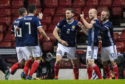 Scotland's players celebrate the deflected opener against Albania.