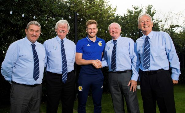 Stuart Armstrong with representatives from Dyce Boys Club.