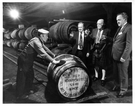 1985: Warehouseman James Alexander pushes the first barrel since the change to natural gas at Glen Garioch Distillery at Oldmeldrum