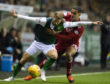 Hibernian's Martin Boyle (left) holds off Aberdeen's Max Love.
