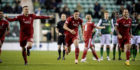 Aberdeen players celebrate winning the penalty shoot-out against Hibs.