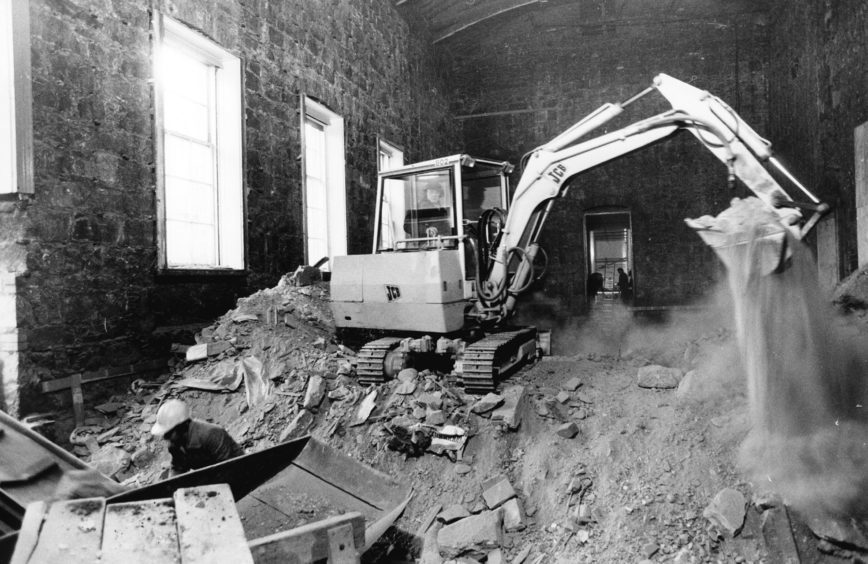 1985: The small ballroom of the Music Hall stripped bare and a digger hard at work during the 1985 refurbishment