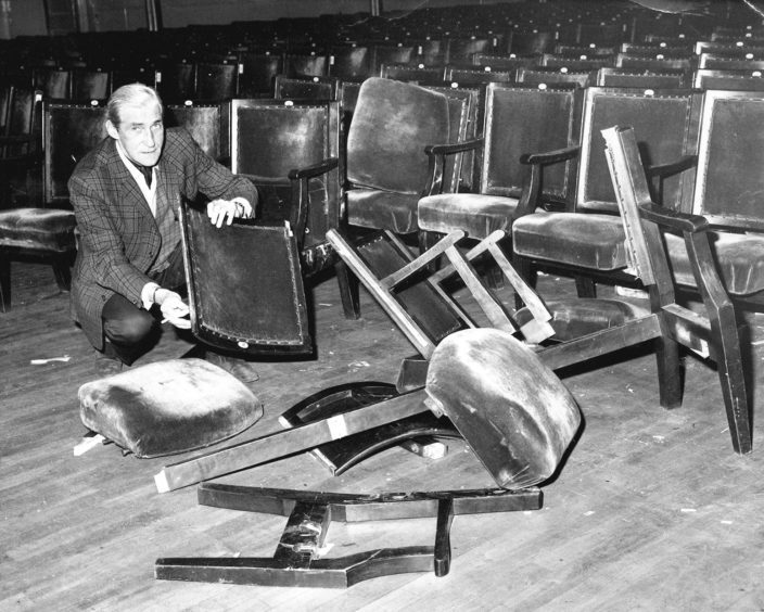 1985: D: Hallkeeper Ted Burnett looks at damage caused in the Music Hall after a gig by The Clash