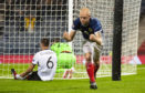 Scotland's Steven Naismith celebrate's the first goal which deflected in off Berat Xhimshiti.