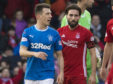 Rangers' Ryan Jack is led away by Aberdeen's Graeme Shinnie after he is sent off last season.