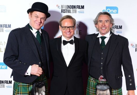 Steve Coogan and Jon C Reilly stand alongside director Jon S Baird at the premiere