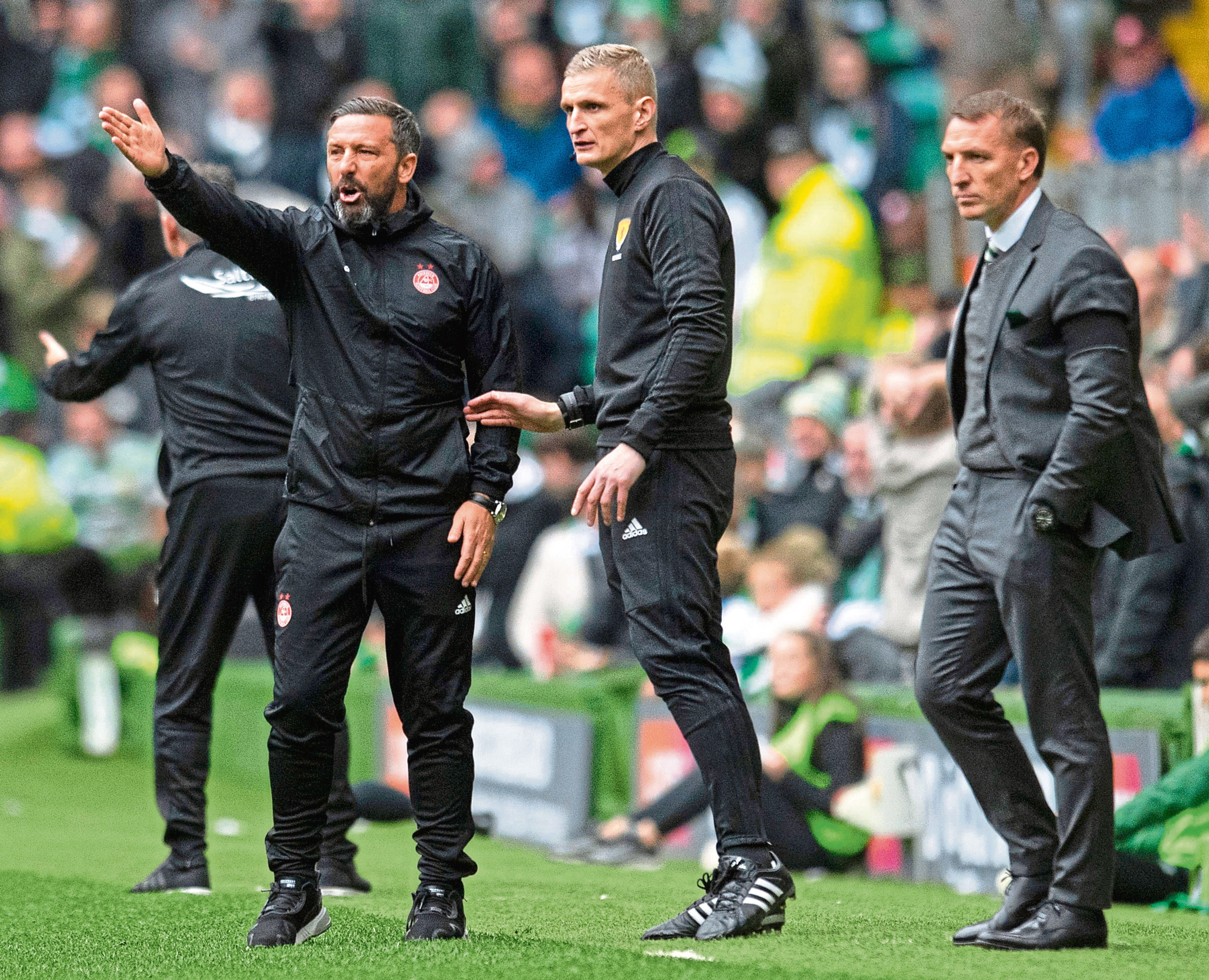 Aberdeen manager Derek McInnes (left) with Celtic manager Brendan Rodgers on the touchline.