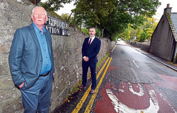 At Pitfodels Station Road are George Murdoch's nephew Alex McKay, left, and Detective Inspector Gary Winter