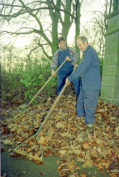1994: Workers sweep up the autumn leaves at Duthie Park in November 1994