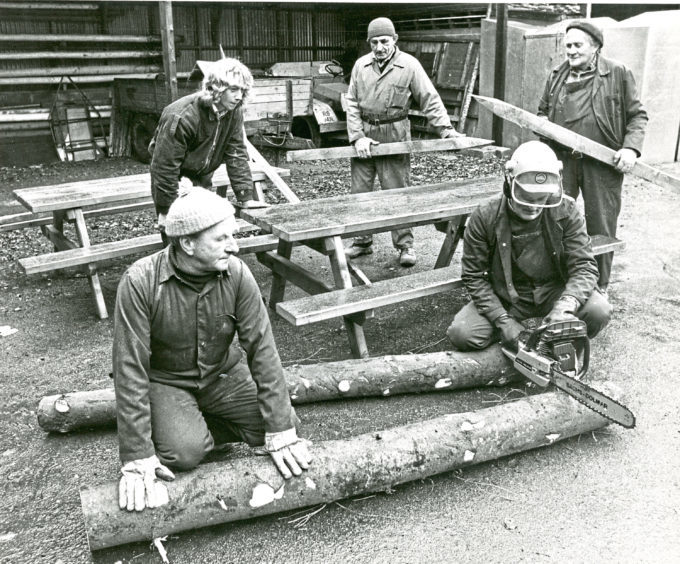 1980: Rear, from left, Jimmy Nicol, Donald Junor and James Strath and, kneeling, Harold Gray and Adam Cassle, with some of the fence posts and park furniture they'd made in the sawmill at Hazlehead Park