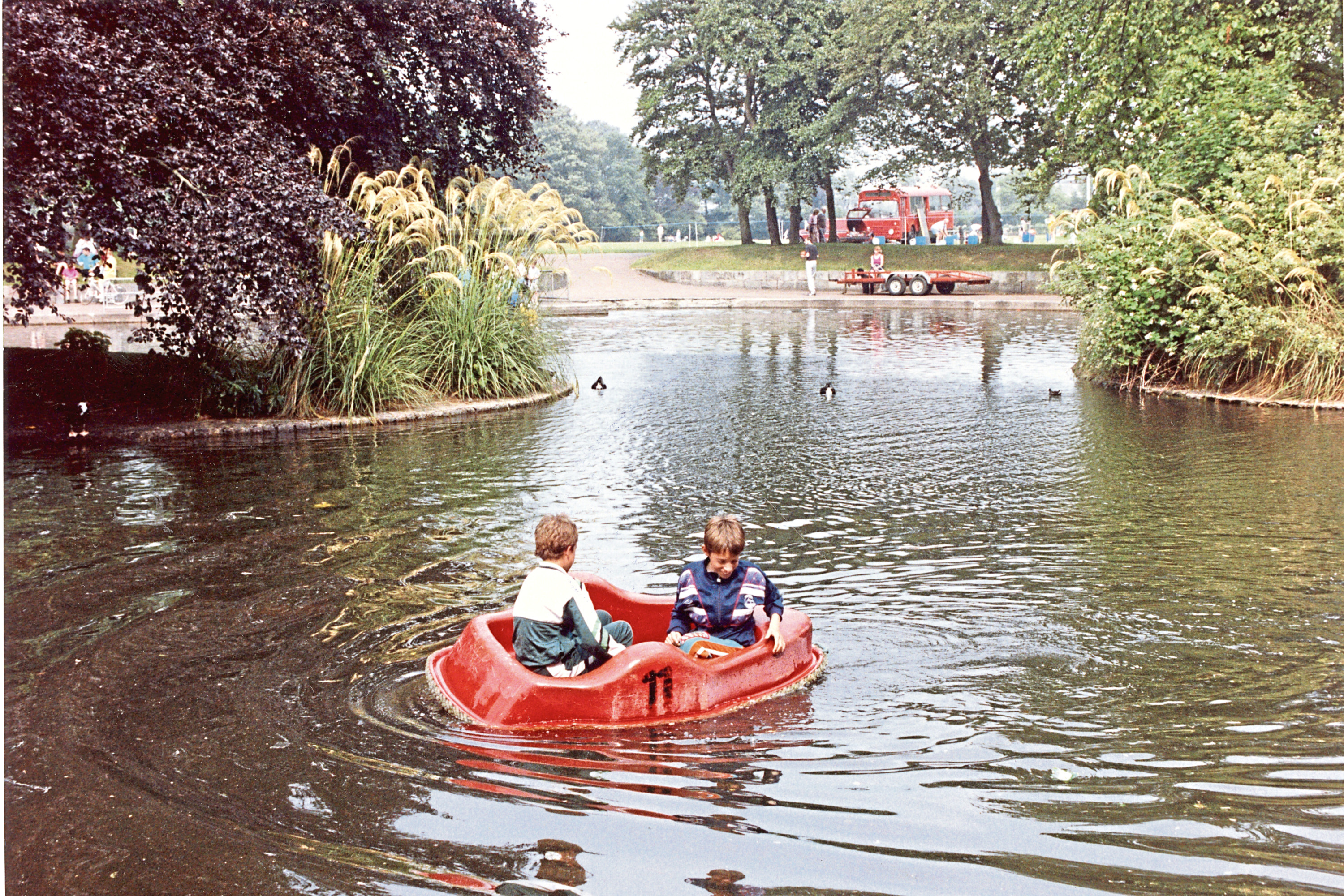 1990: Two boys out on a pedalo on the boating pond in Duthie Park