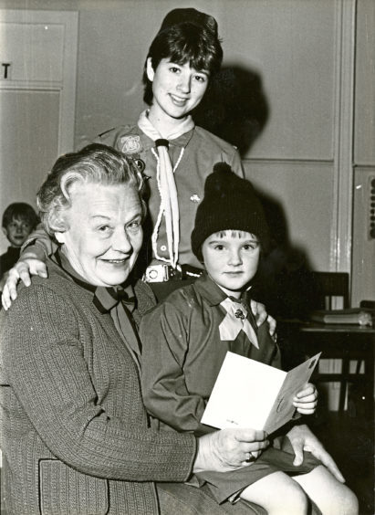 1985: Peggy Saxon, a founder Guide of the 1st Dyce Girl Guides, with Brownie Suzanne Clark and Guide Nicola McWilliam to celebrate the 1st Dyce Brownie Pack's 50th anniversary