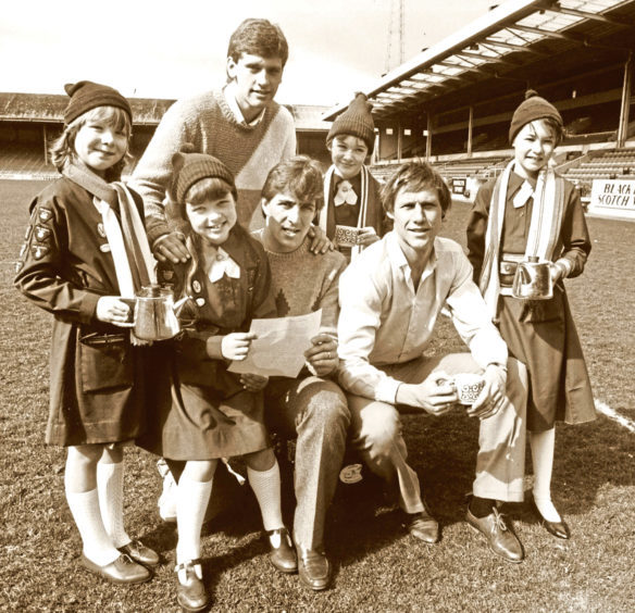 1984: The 3rd Bridge of Don Brownies served up tea for Dons players Eric Black, back, Mark McGhee, centre, and Doug Rougvie