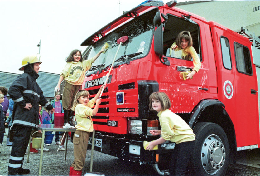1995: Inverurie 5th and 6th Brownies had a splash washing the town's fire engine in 1995 to raise money for Wateraid in Ethiopia and India