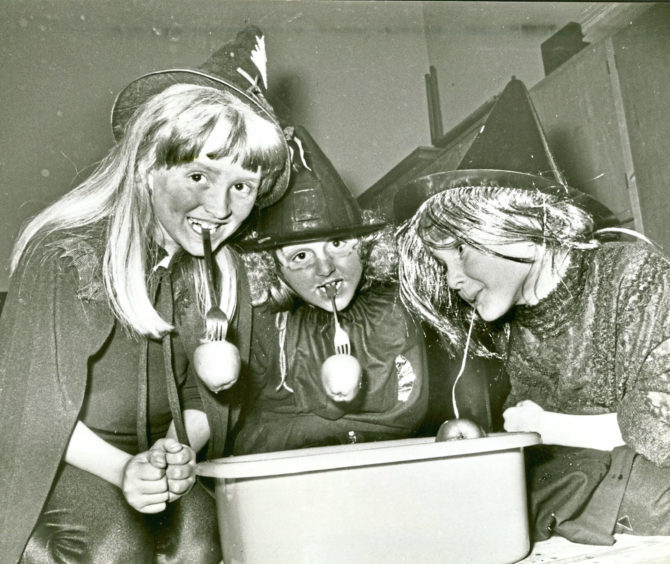 1985: Brownies Elizabeth Chapman, Lindsey Orchard and Claire Hunter  dook for apples during a Halloween party in Ferryhill South Church hall