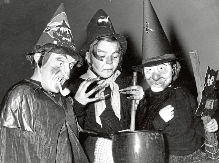 1960: Three Beechgrove Brownies put on a spooky display dressed as witches for their Halloween party