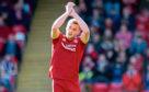 Aberdeen's James Wilson applauds the fans as he is substituted.