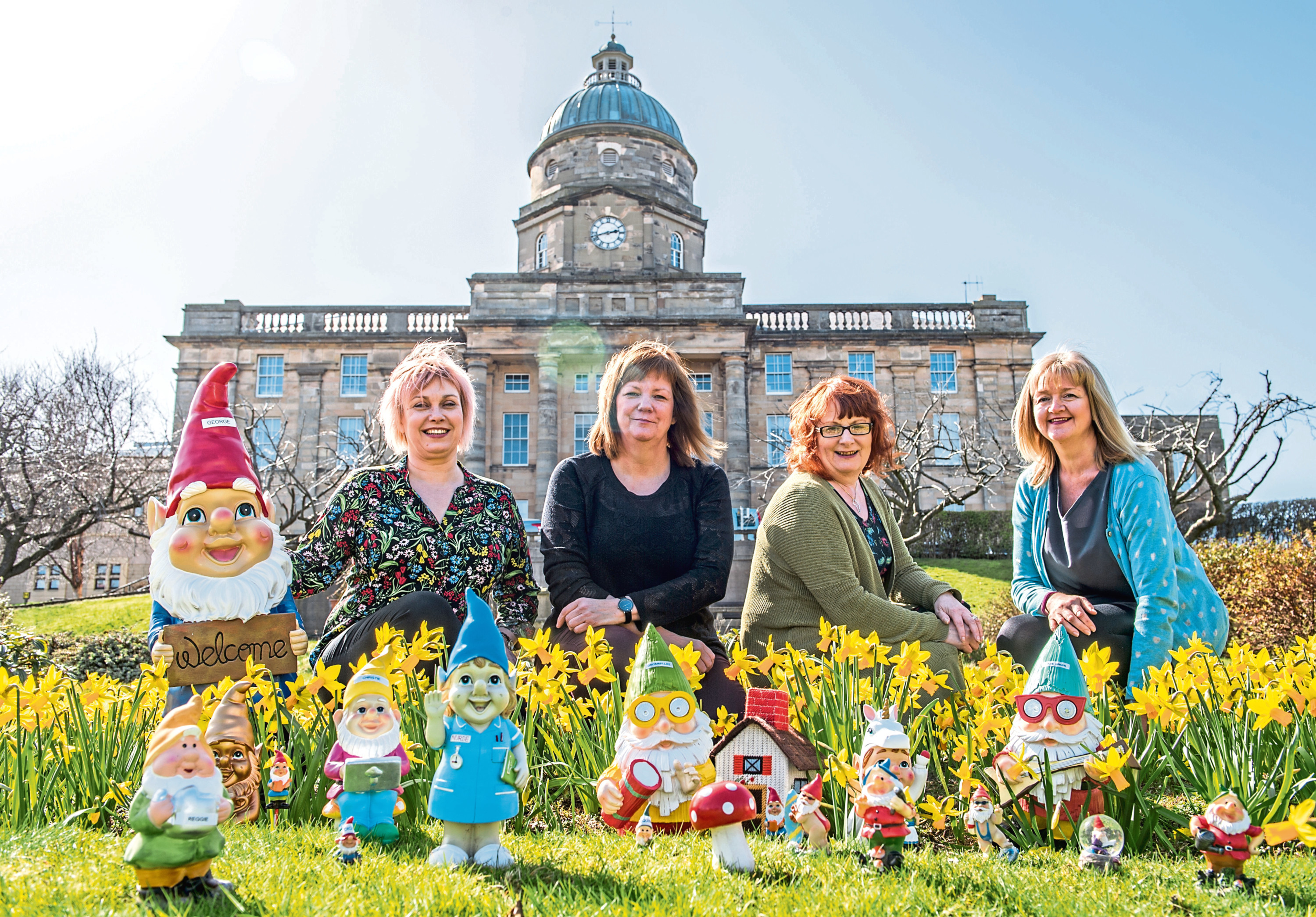 Dr Gray's fundraisers, from left, Karin Howard, Kate Cowie, Trish Bury and Lorna Young. Inset below, the Halloween-themed gnomes.
