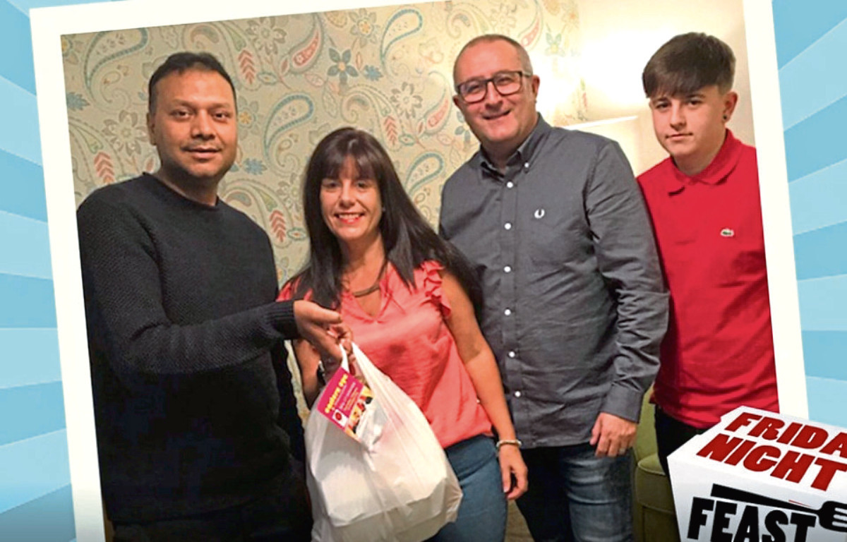 Ann McRobb with her family after getting her takeaway delivered