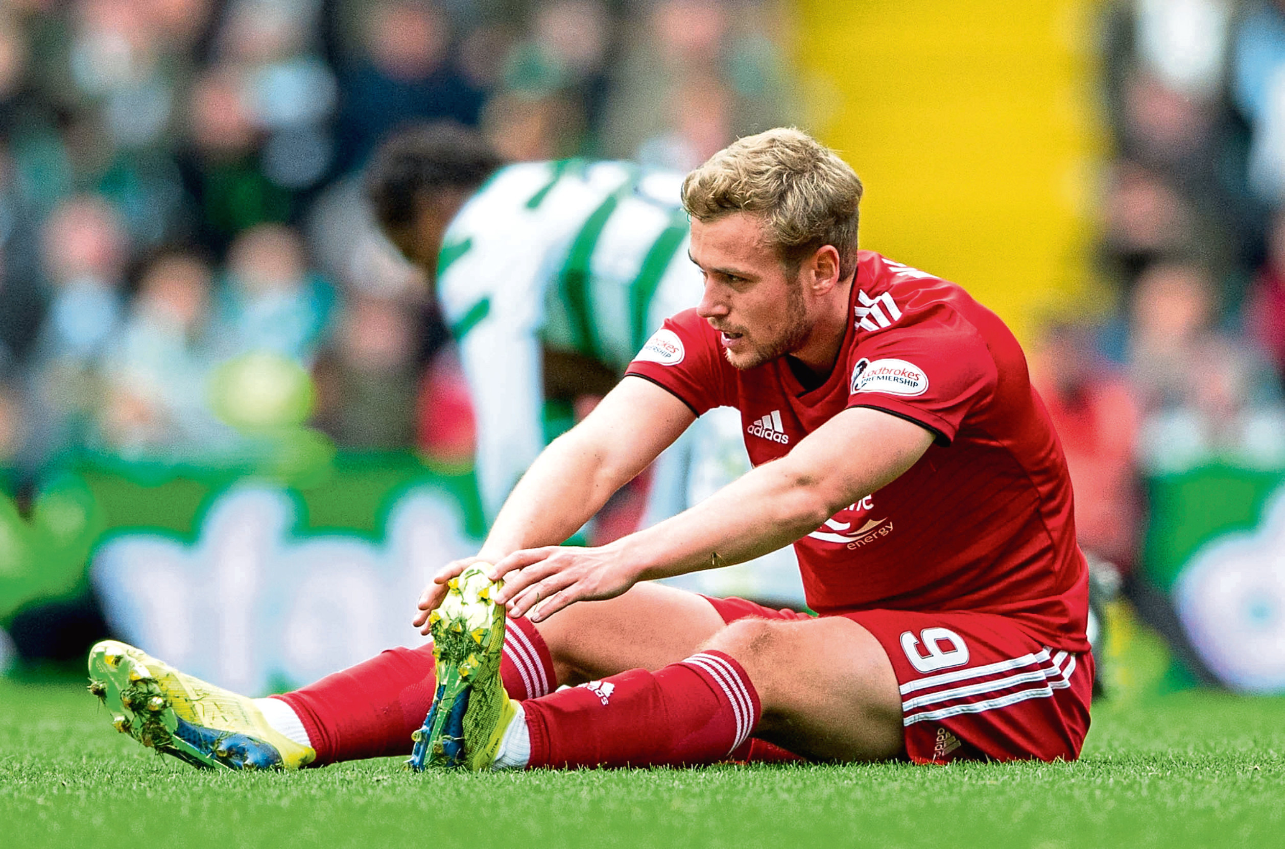 Aberdeen's James Wilson stretches out before being replaced at Parkhead a couple of weeks ago.