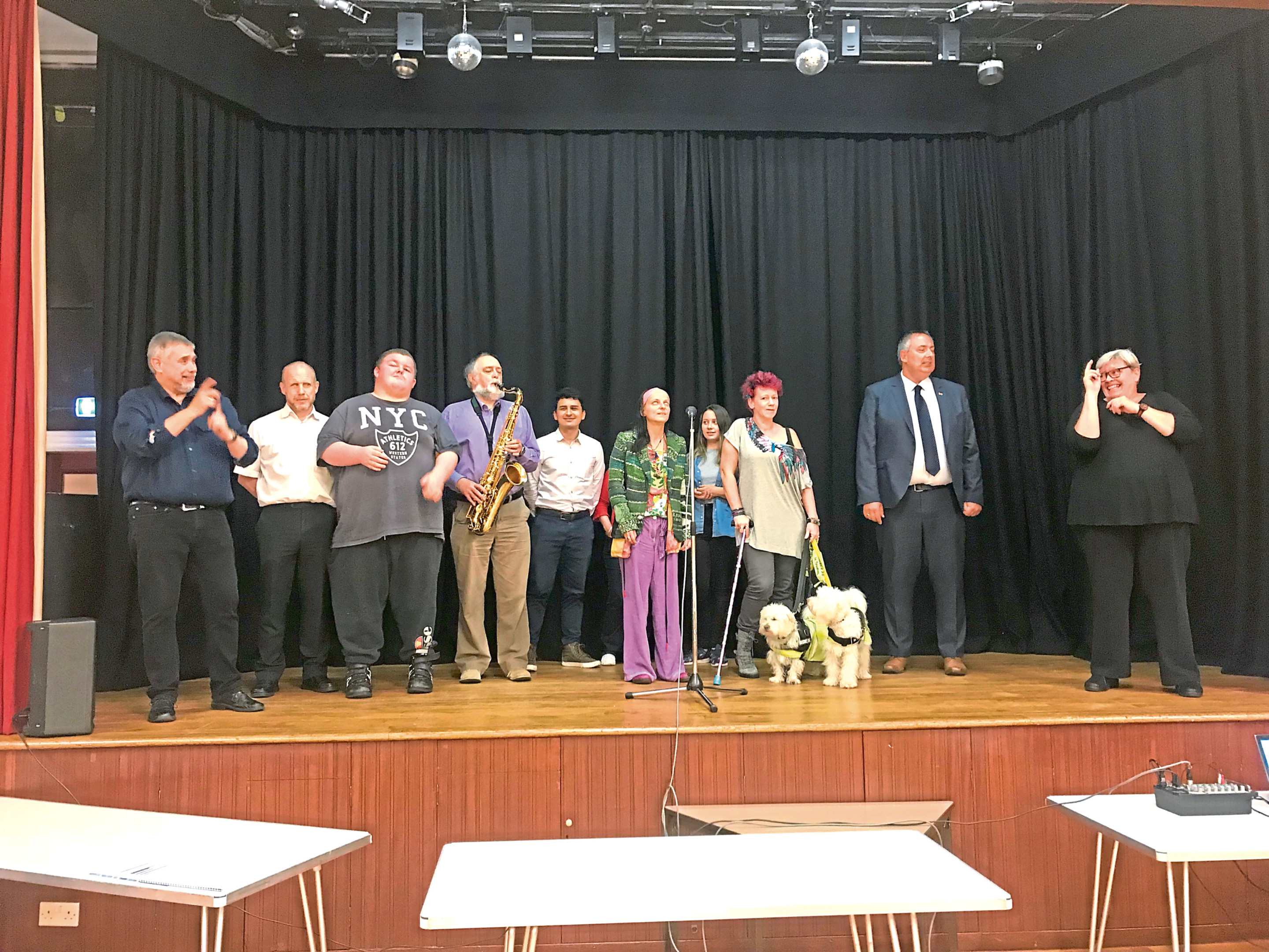 Some of the service users on stage during the rehearsal