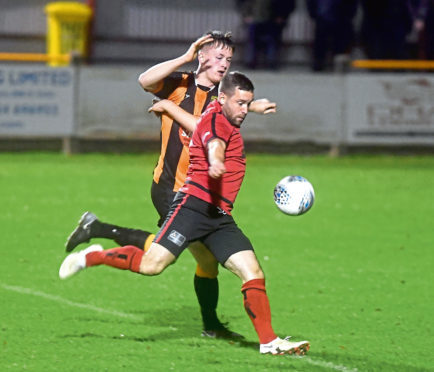 Huntly's Ryan McRitchie and Inverurie's Neil Gauld. Picture by Chris Sumner.