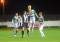 Buckie's Lewis MacKinnon and Fraserburgh's Willie West battle last term. Picture by Heather Fowlie
