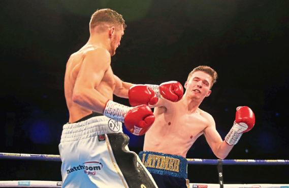 John Docherty knocks down Jordan Latimer  during a super-bantamweight contest at Metro Radio Arena on October 13, 2018 in Newcastle upon Tyne, England.