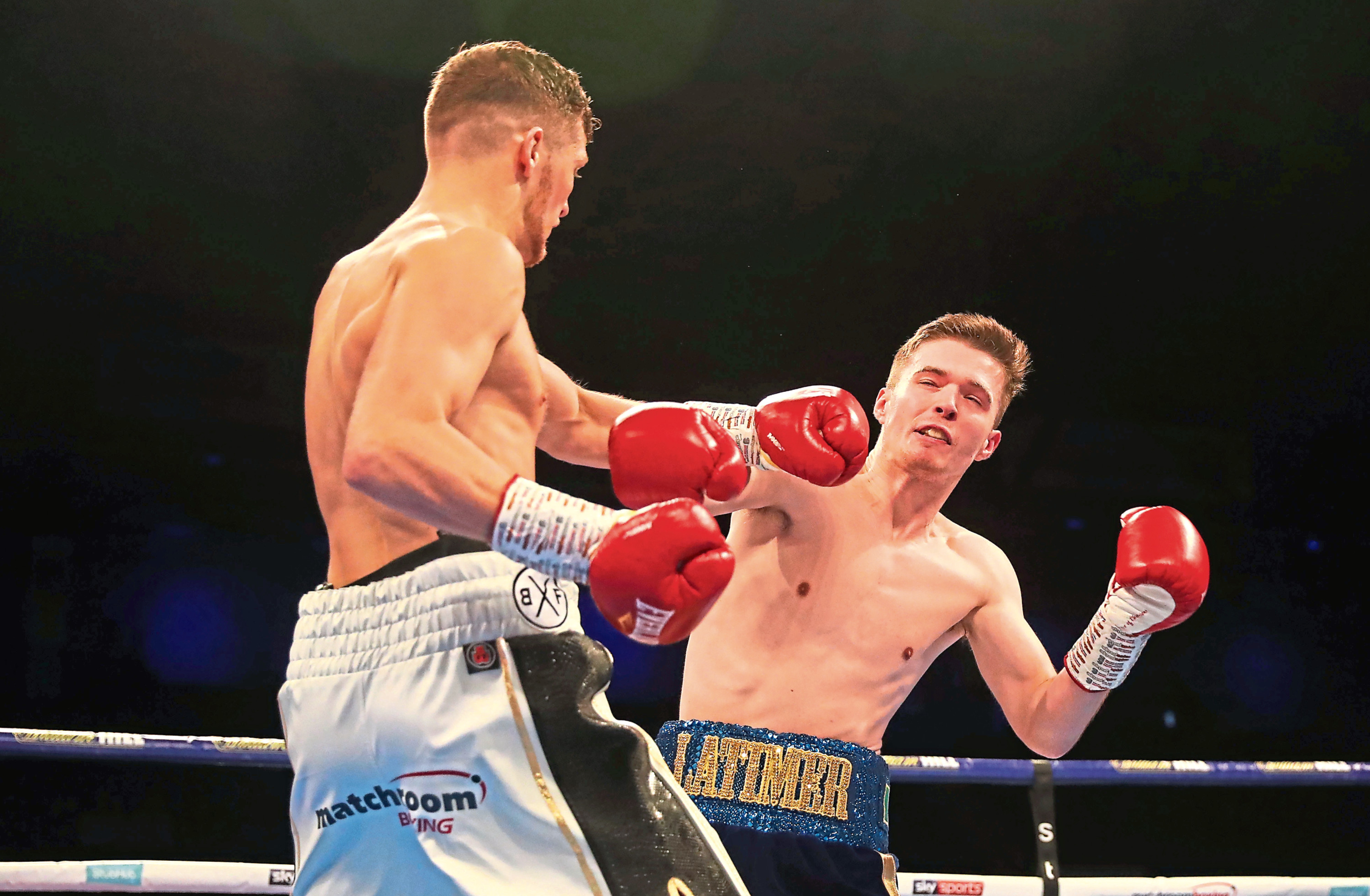 John Docherty knocks down Jordan Latimer  during a super-bantamweight contest at Metro Radio Arena on October 13, 2018 in Newcastle upon Tyne, England.