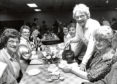 1989: Rayne WRI member Muriel Moir, serving up  tea, was a welcome sight for these show visitors taking a break from touring the exhibit