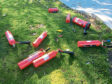 Fire extinguishers found abandoned in a city playpark are thought to have been taken during a break-in at the derelict Kincorth Academy