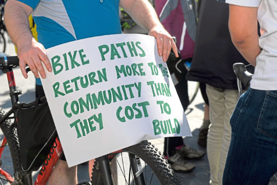 The Aberdeen Cycle Forum held a protest outside Marischal College against the lack of provision for cyclists on the AWPR