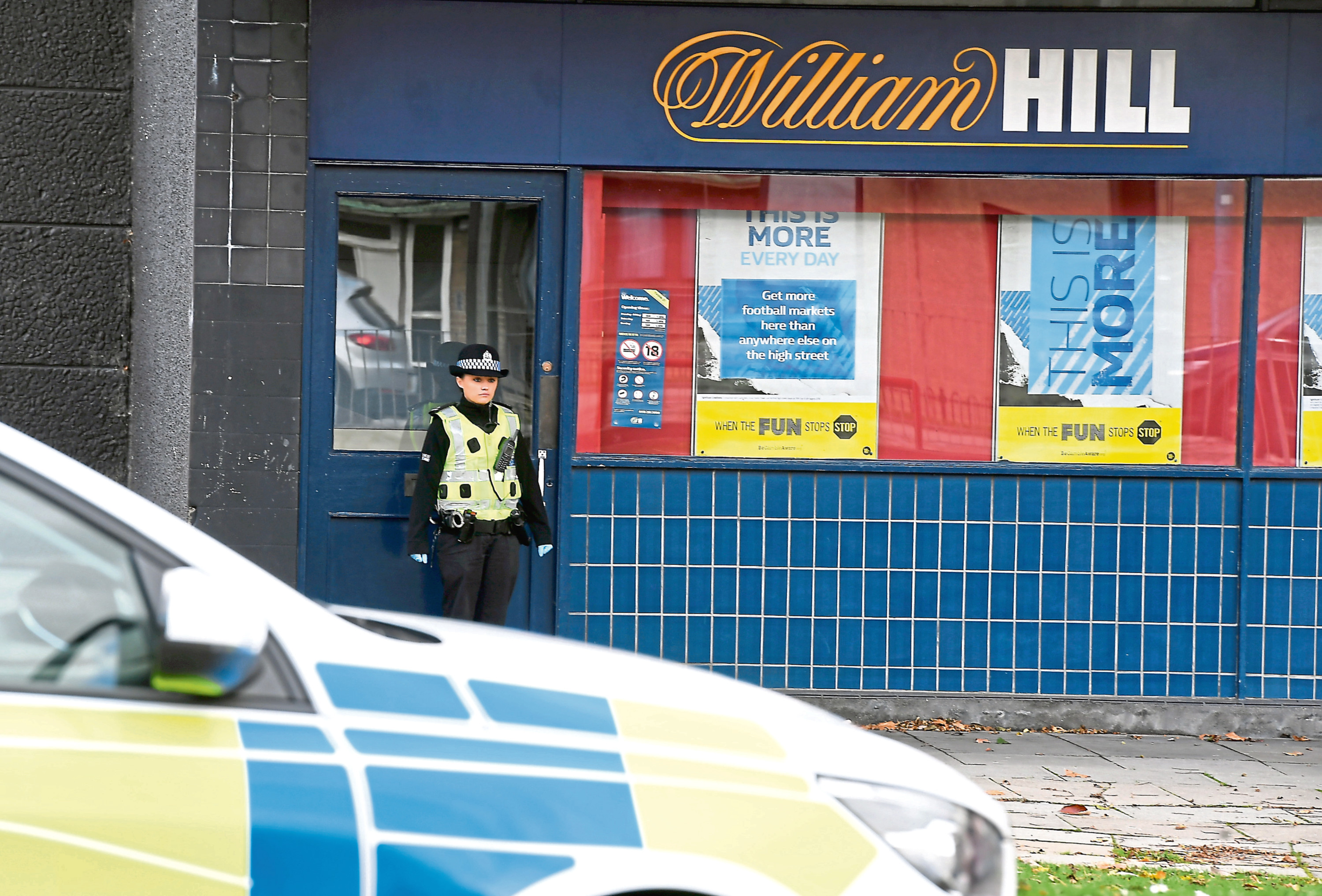 Police at the William Hill shop in Summerhill