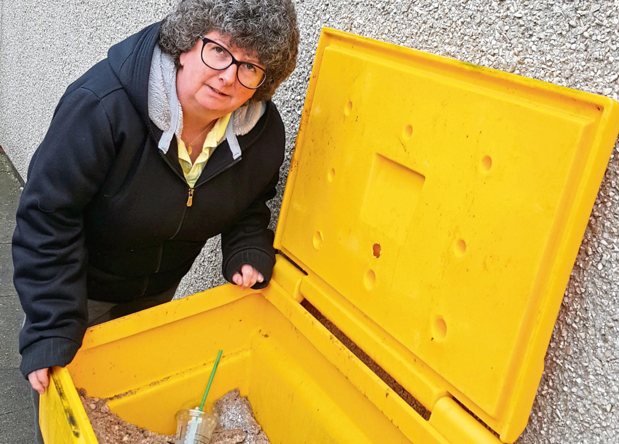 Gillian Owen with a grit bin in Ellon