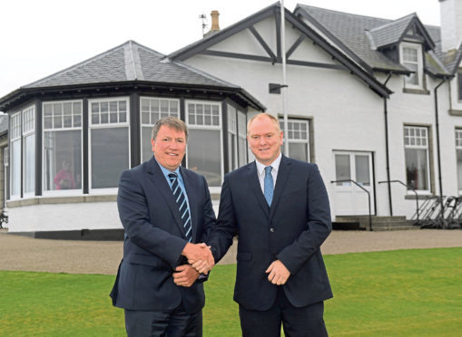 From left, Shaun George welcomes new appointment Keith Grant. Picture by Kath Flannery