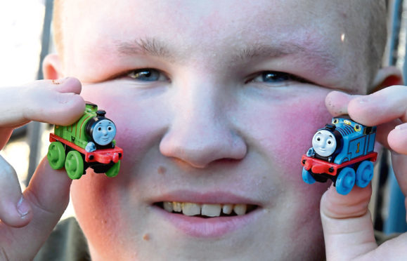 Pictured is Liam McIntyre with sone of his collection of Thomas the Tank Engine trains