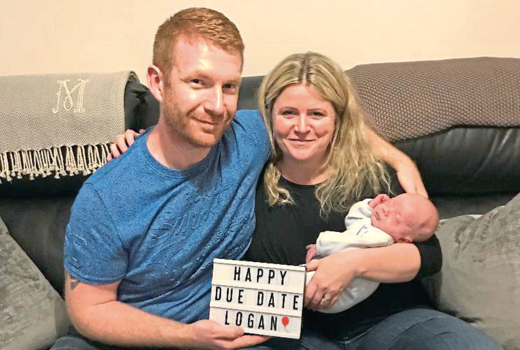 Logan Meek, who was born at the end of August, with mum Hazel and dad David