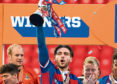 Inverness's George Oakley lifts the Irn-Bru Cup.