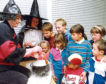 1991: Marion Wands, left, and Gabrielle Shields concoct a brew for a group of enchanted children at Bucksburn Library to enjoy