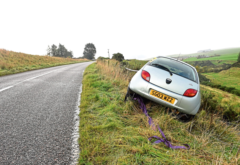 Farm worker Ian Simpson's car ended up down an embankment