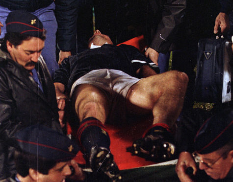 Ally McCoist with a broken leg during the match with Portugal at the Estadio de Luz.